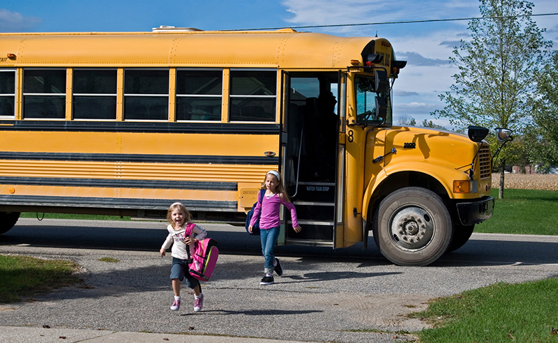 children stepping off the bus