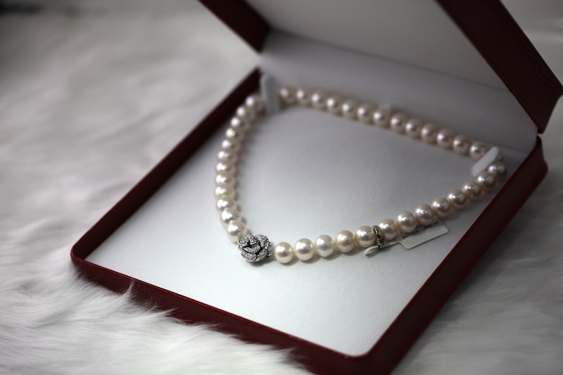 a pearl necklace in a box